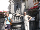 "Famous place of Belgium, Brussels - ""Pissing Boy"" (Manneken Pis). The man near me trying to look similar as boy."
