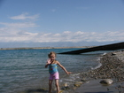 Yes, she is ready to swim in the usual clothing, just let her do it! Indeed, she loves to swim in Issyk-Kul Lake.