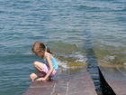 While it was not good to swim, we allowed Lyuba to dangle her legs in the water sitting on the old pier.