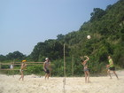 Sasha and Olya, Sergey and Lyuba are playing beach volleyball on the sand of Koh Rin island.