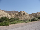 Some more interesting mountains/hills. Clay or sand is one of components of there small rocks. Near town Balykchy (former Rybachye or Rybachie)