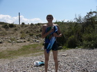 I am standing on the shore after swimming in the Lake Issyk-Kul.
