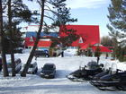 The parking place in front of administration building of Karakol ski base.