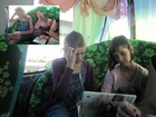 Girls in the bus. First they started to watch some movie but then fell asleep.