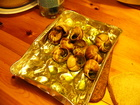 "One day we were eating these snails for the dinner. This is a usual meal in tis part of Europe. Snails were big, ""fat"", with garlic sauce cooked in oven. That was unusual but tasteful."